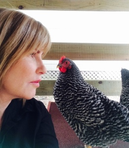 Darrelyn in the chicken coop with Jennie Lee